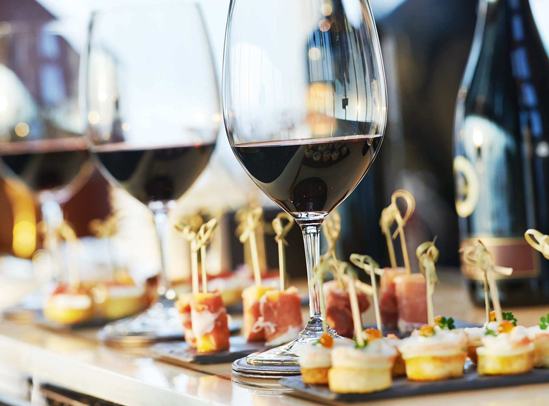 Wine glasses and appetizers on serving tray
